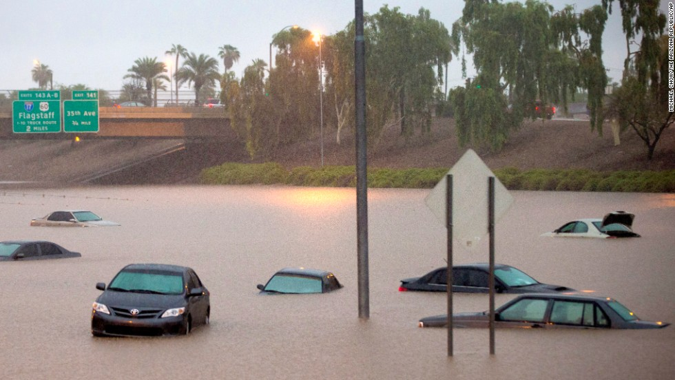 "Cars are stuck in floodwaters on Interstate 10 in Phoenix on Monday, September 8. Record-setting rains slammed the southwestern United States on Monday, <a href=""http://www.cnn.com/2014/09/08/us/arizona-flooding/index.html"">turning roadways into rivers</a> as flash floods washed away cars."