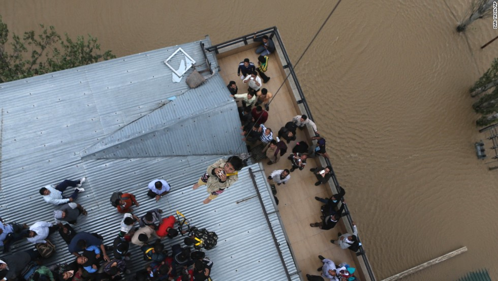 "A woman is airlifted from the roof of a five-story hotel in Srinagar, India, on Tuesday, September 9. More than 400 people have been killed in <a href=""http://www.cnn.com/2014/09/05/asia/gallery/monsoon-flooding/index.html"">flooding caused by intense monsoon rains</a> across northern India and Pakistan. Thousands have been stranded."