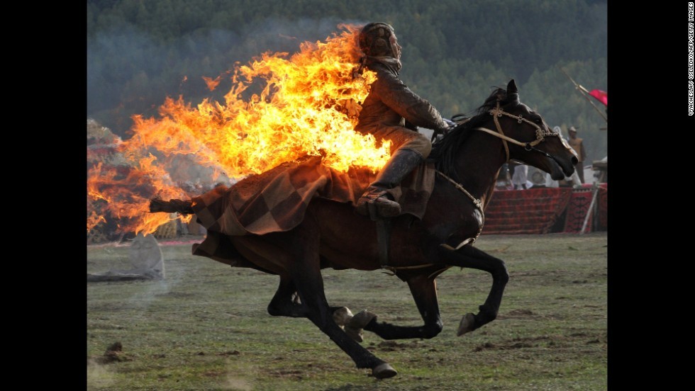 A stuntman performs Wednesday, September 10, in Kyrgyzstan during the first-ever World Nomad Games. Teams from the host country competed in various competitions against teams from Azerbaijan, Belarus, Kazakhstan, Mongolia and Tajikistan.