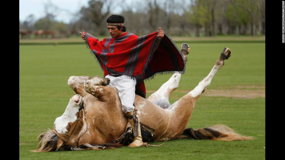 "Martin Tata sits on his horse Primavera as he performs a demonstration of ""Indian taming"" Tuesday, September 9, at a ranch in Canuelas, Argentina. Tata says the techniques he uses to tame horses avoid unnecessary violence and help build a more harmonious relationship between humans and horses."