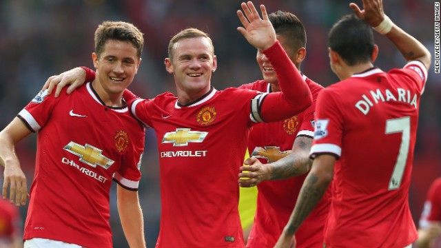 Manchester United stars celebrate Wayne Rooney's third goal in the 4-0 win over QPR at Old Trafford.