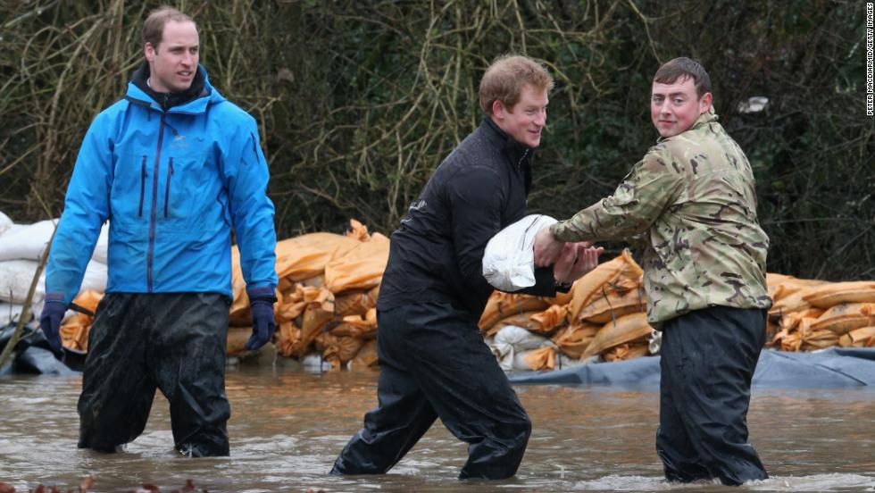 Prince Harry and Prince William help soldiers build a flood wall at Eton End School on February 14 in Datchet, England.