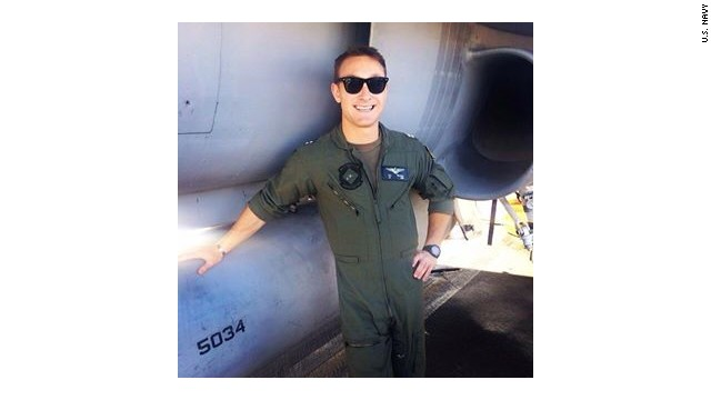 Navy pilot missing and presumed dead after two jets collided over the western Pacific Ocean has been identified as Lt. Nathan Poloski, 26, of Lake Arrowhead, California.