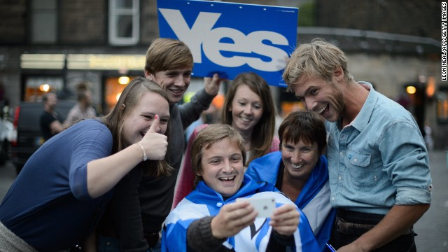 "Separatist campaign supporters take a selfie outside Usher Hall ahead of the ""A Night for Scotland"" concert in Edinburgh, Scotland, on Sunday, September 14."