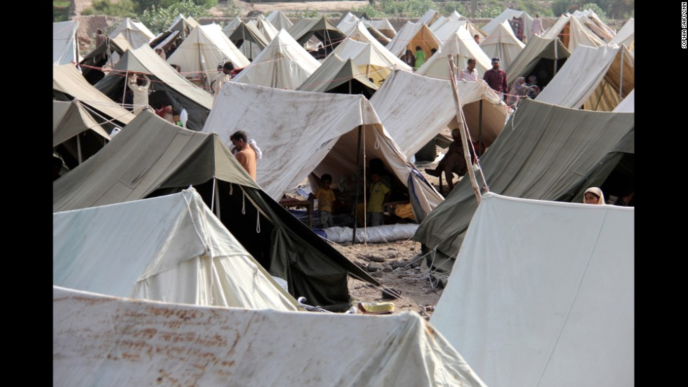 People walk around a relief camp set up by the Pakistani government on the outskirts of Multan.