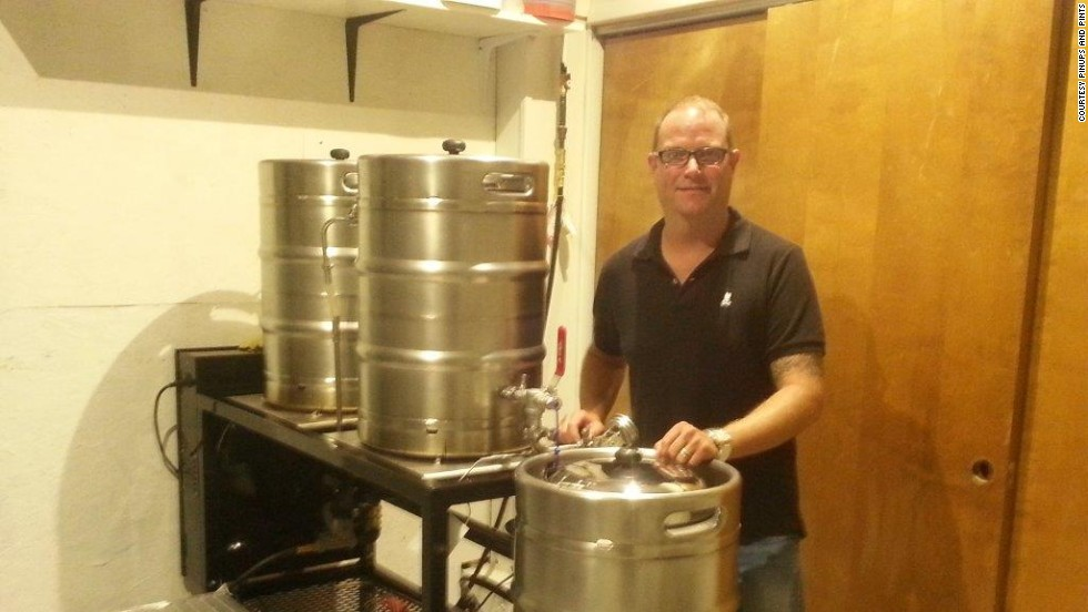 Club owner Scott Conrad oversees beer production backstage.