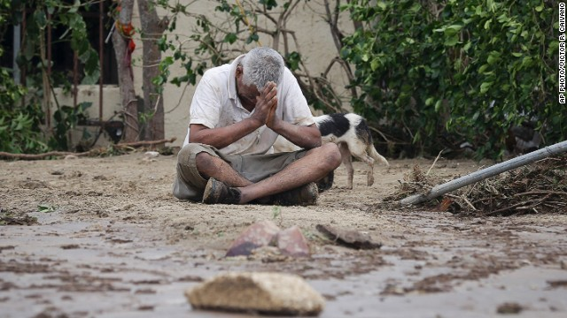 Enrique Cota Ceceña cries after finding that his house was severely damaged by flood waters from Hurricane Odile in Los Cabos, Mexico, on September 15, 2014.