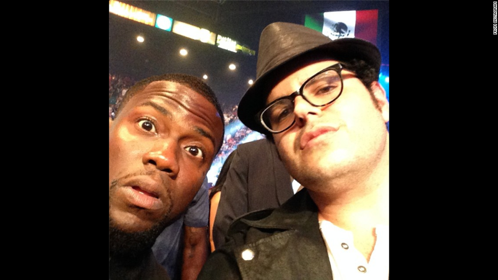 "Comedian Kevin Hart, left, sits ringside with actor Josh Gad at the boxing event headlined by Floyd Mayweather on Saturday, September 13, in Las Vegas. ""I treated him to this fight and he's blown away,"" <a href=""http://instagram.com/p/s6zm0oCYpu/"" target=""_blank"">wrote Hart,</a> who will appear with Gad in the upcoming movie ""The Wedding Ringer."""