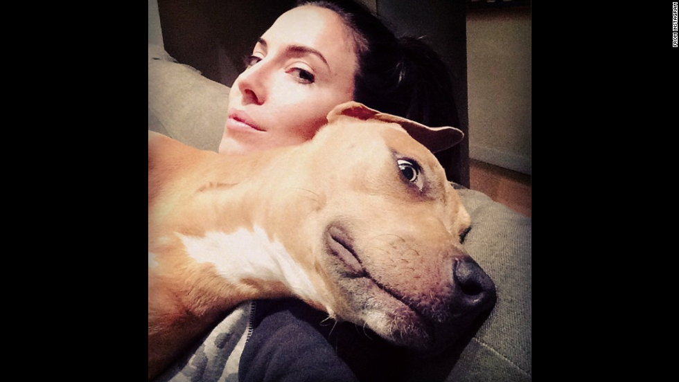 "Comedian Whitney Cummings <a href=""http://instagram.com/p/s1XNHDkmVp/"" target=""_blank"">takes a photo of her dog</a> Friday, September 12. ""She pretends to be asleep so I won't get up,"" Cummings said on Instagram. ""Busted."""