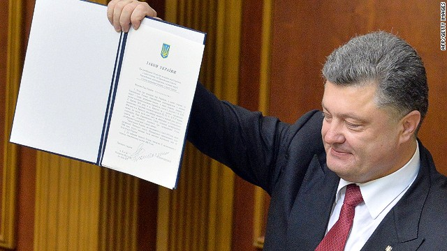 Ukrainian President Petro Poroshenko shows a newly voted Ukrainian law about the ratification of the Ukraine-EU association agreement on September 16, 2014 at the Ukrainian Parliament in Kiev. The Ukrainian and European parliaments on September 16 simultaneously ratified a landmark pact at the heart of the ex-Soviet country's bloodiest crisis since independence. AFP PHOTO/GENYA SAVILOVGENYA SAVILOV/AFP/Getty Images
