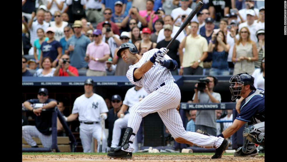 Jeter connects on a solo home run for his 3,000th career hit on July 9, 2011. He was the 28th player in Major League history to reach the milestone.