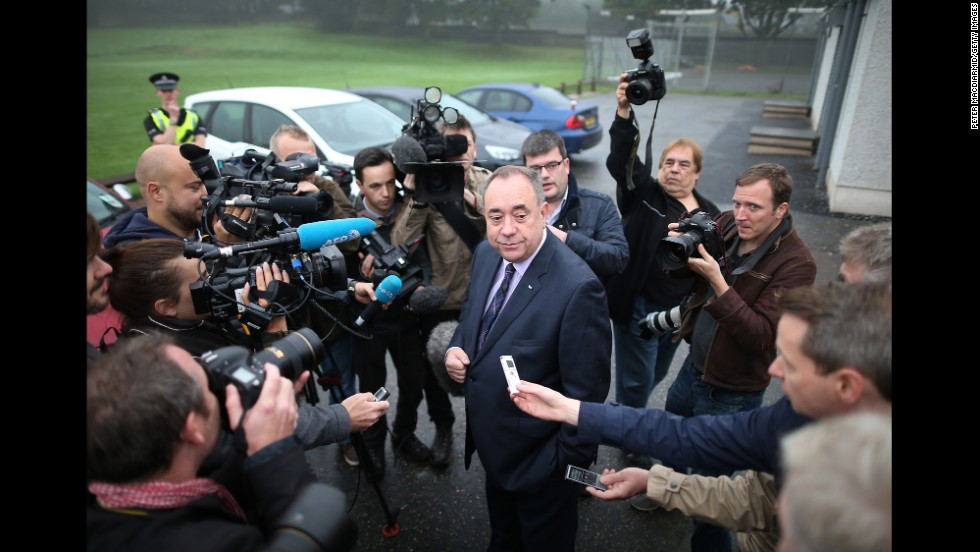 Salmond chats with reporters after casting his vote September 18 in Strichen, Scotland.