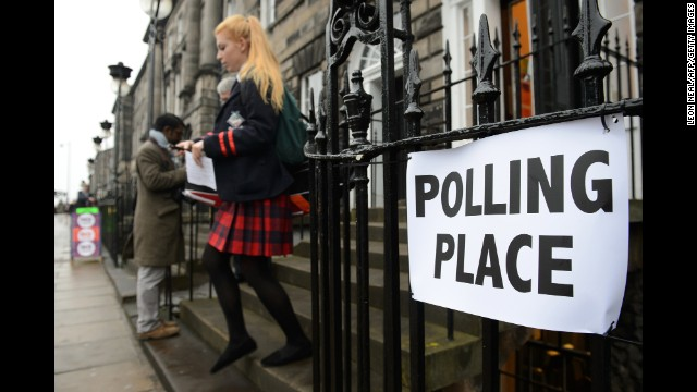A young voter leaves a polling station in Edinburgh.