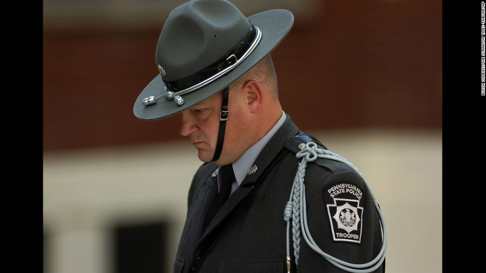 A Pennsylvania state trooper arrives for the viewing of Dickson's body.