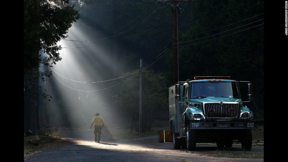 A firefighter walks through smoke in Fresh Pond on Wednesday, September 17.