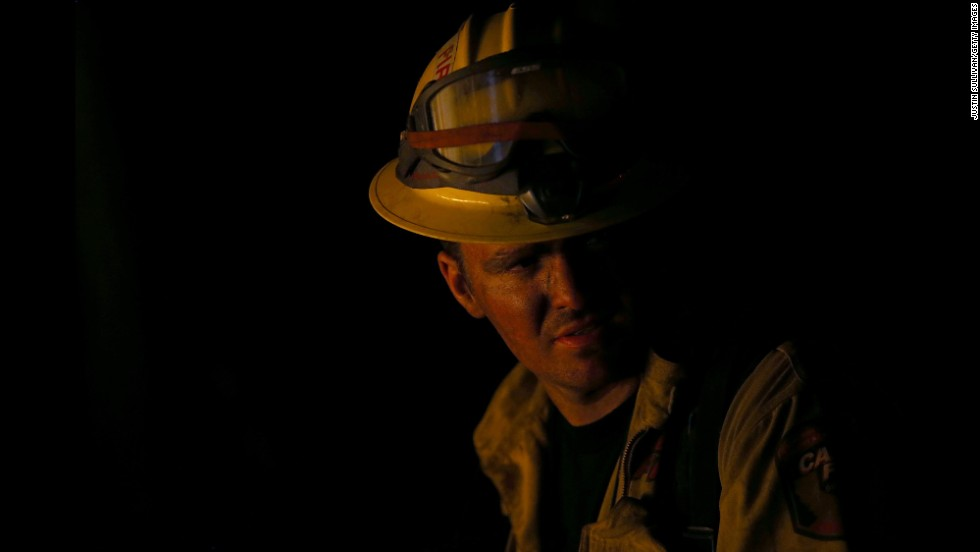 A firefighter monitors a backfire in Fresh Pond on September 17.