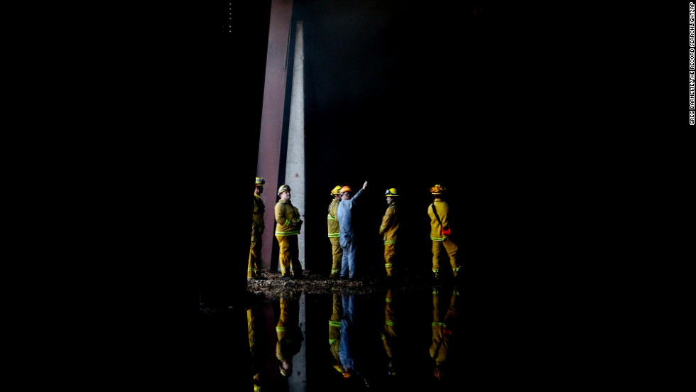 Firefighters inspect the interior of the Roseburg lumber mill in Weed on September 16.
