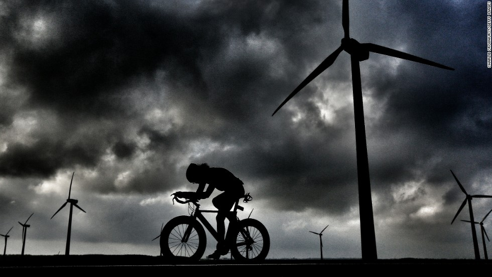 """I really liked this shot of a single cyclist set against the windmills,"" said Crowhurst, of this dark image taken at the Challenge Almere event in the Netherlands."