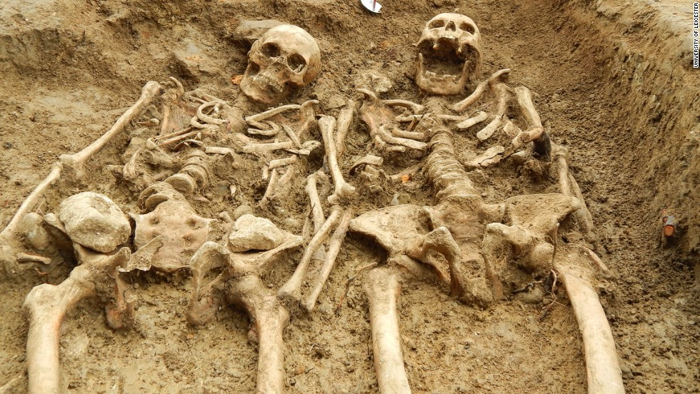 "A couple of skeletons which have been ""holding hands"" for 700 years have been uncovered at the lost chapel of St Morrell in Leicestershire, central England."