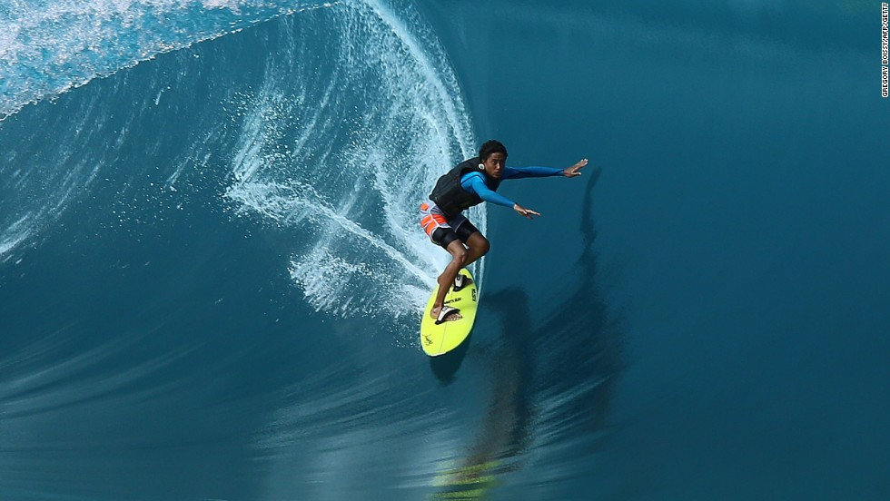 Local 17-year-old surfer Matahi Drollet shows his skills during the filming in the Hava'e pass in Teahupoo.