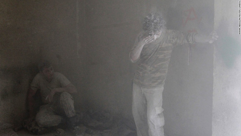 Free Syrian Army fighters rest inside a damaged room in Aleppo on Tuesday, September 16, during what activists said were clashes with forces loyal to al-Assad.