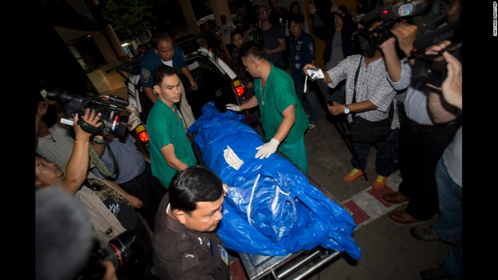 Miller's body is carried to a forensic police facility in Bangkok on Tuesday, September 16.