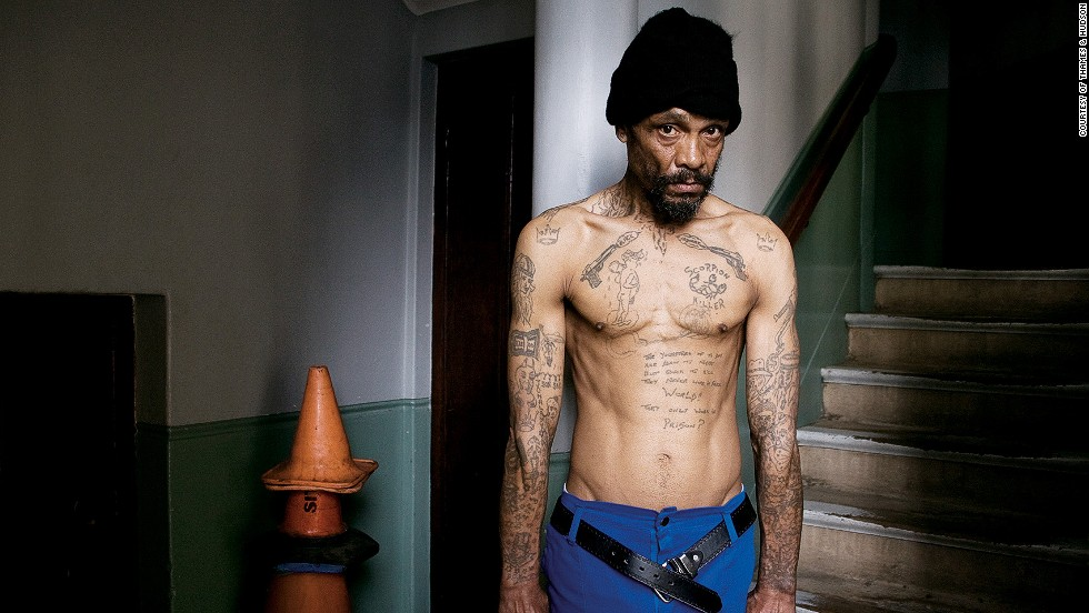 The impulse to identify with a tribe can also be seen in criminal contexts. A former high-ranking gang member in Cape Town, South Africa, shows off his gangland tattoos. When this picture was taken, in 2007, he had retired and was working as a cleaner and handyman at St. George's Cathedral in Cape Town.