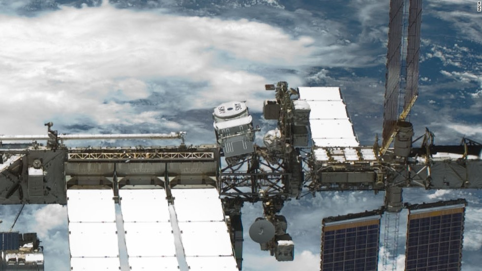 CERN's Alpha Magnetic Spectrometer rides atop the International Space Station to detect signs of mysterious dark matter.