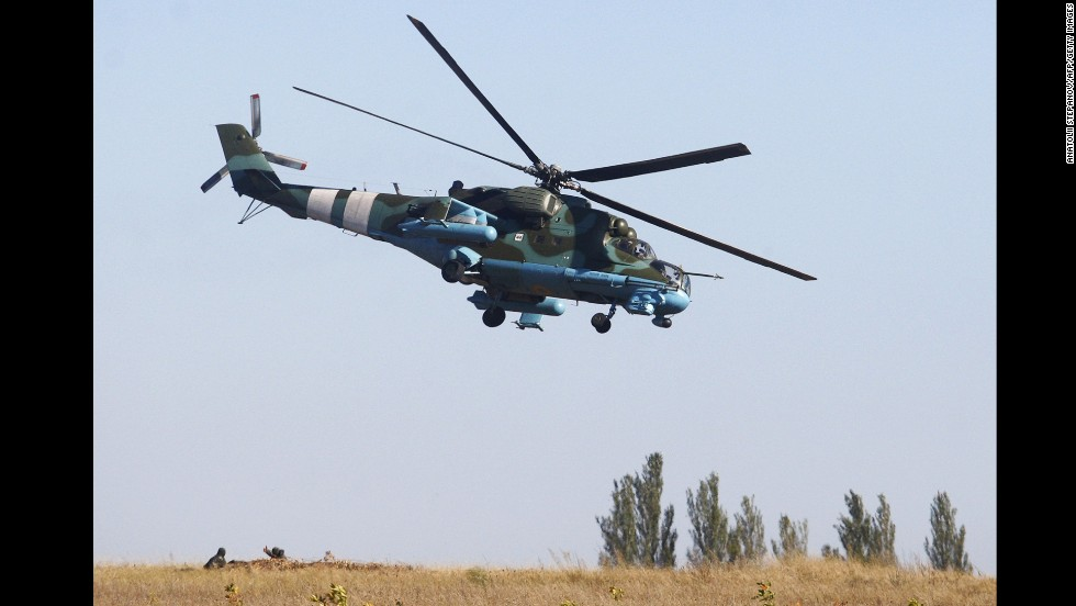 A Ukrainian helicopter patrols an area near Donetsk on September 20.