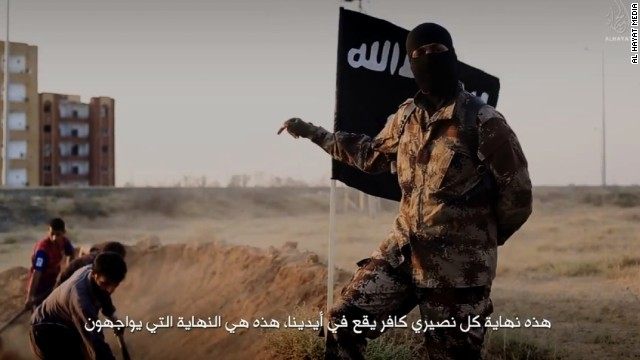 "An ISIS fighter who speaks perfect English with a North American accent is shown orchestrating the mass execution of a group of men in an ISIS recruitment video called ""Flames of War."""