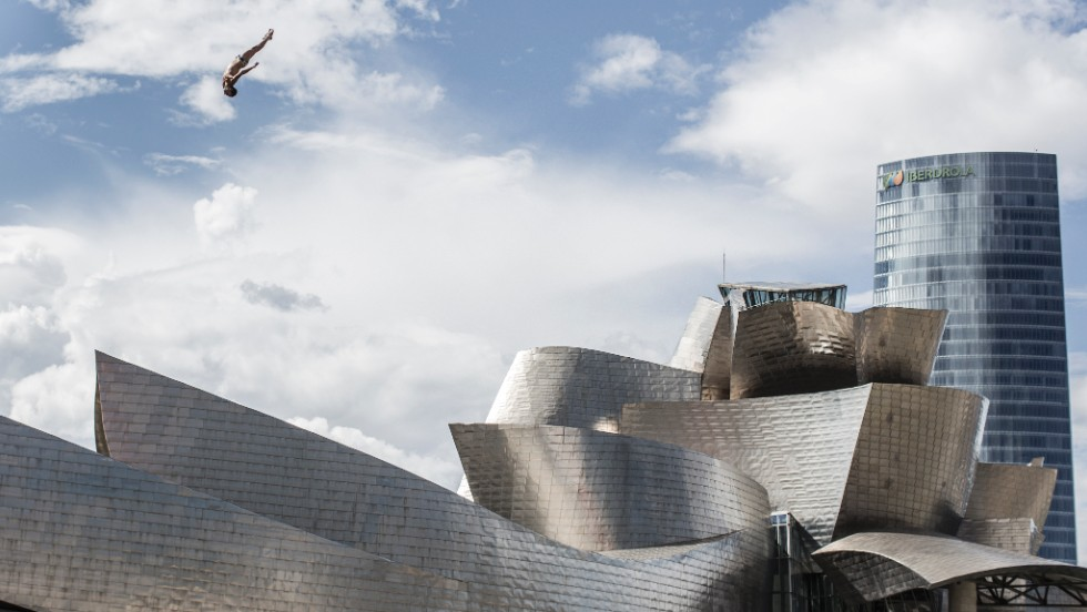Cyrille Oumedjkane of France made this spectacular leap during the competition with the Guggenheim Museum in the background.