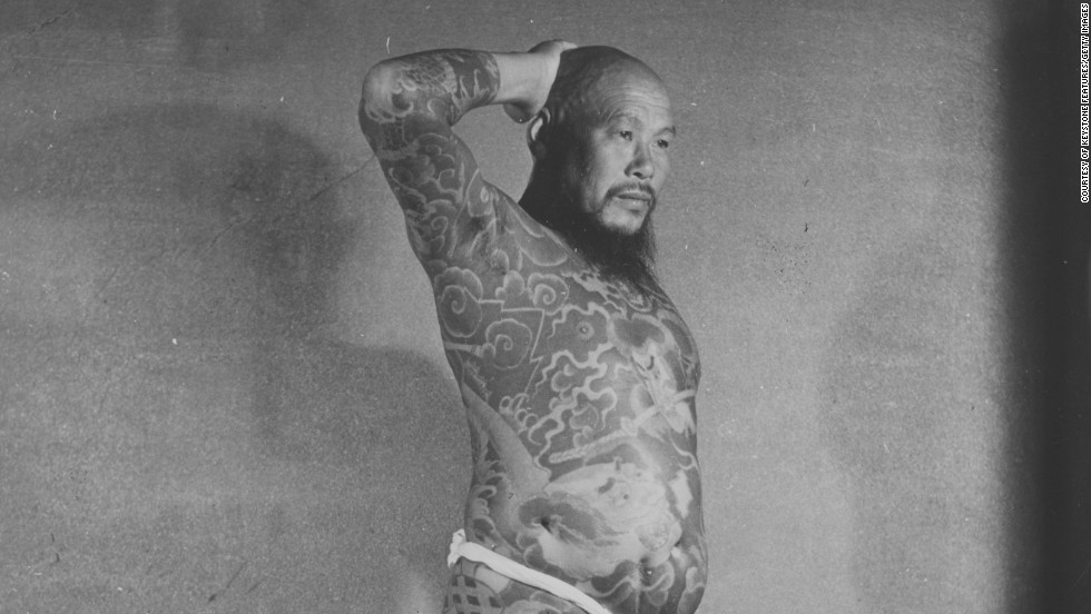 In Japan, a rich tradition of body art, known as Irezumi, stretches back to approximately 10,000 B.C. Tattooing was banned between 1876-1948, when the art form became associated with criminality and gang culture. But once prohibitions were lifted, tattooists were free once again to work without fear of arrest. Here, a Japanese man is pictured in 1958 with full body tattoos.