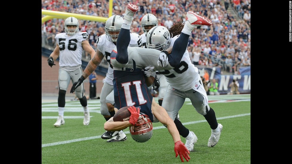 New England Patriots wide receiver Julian Edelman is tackled by Oakland Raiders during the Patriots' 16-9 win Sunday, September 21, in Foxborough, Massachusetts. Edelman had 10 receptions in the game for 84 yards.