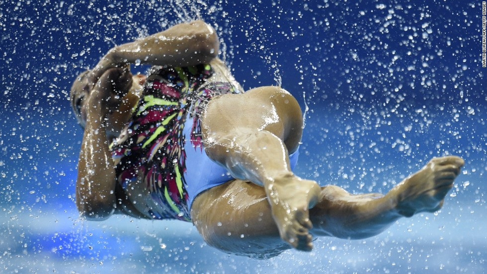 A member of Japan's synchronized swimming team twists out of the water Monday, September 22, while competing in the Asian Games in Incheon, South Korea.