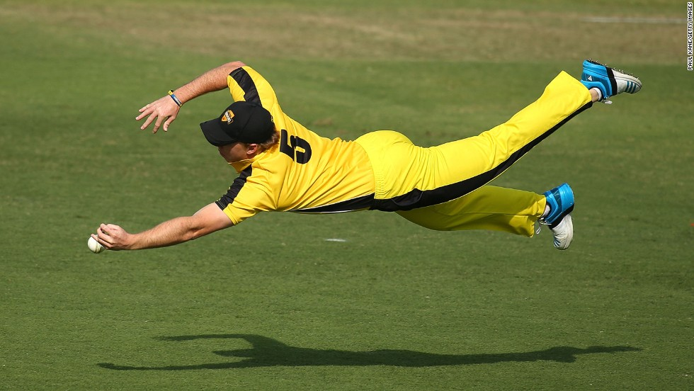 Cricket player Jaron Morgan dives for a catch Monday, September 22, as his Western Australia XI played Afghanistan in a One Day tour match in Perth, Australia.