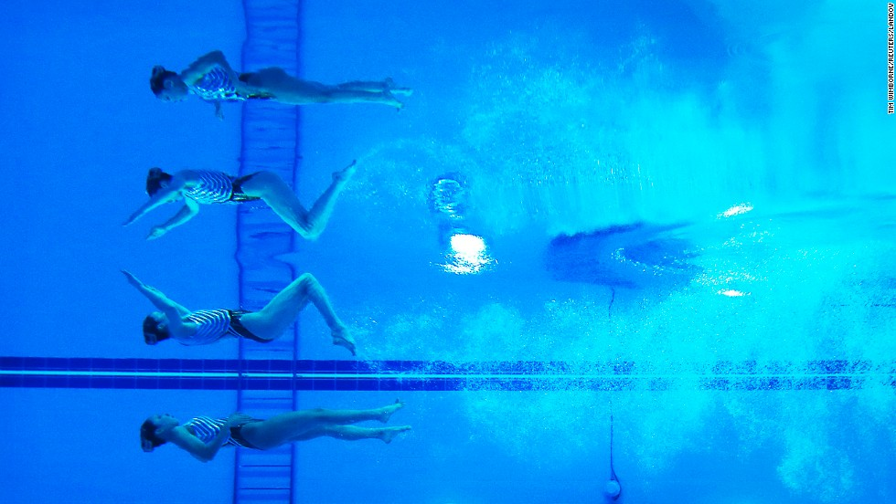 The reflections of Yukiko Inui and Risako Mitsui, two synchronized swimmers from Japan, are seen underwater as they perform at the Asian Games in Incheon, South Korea, on Saturday, September 20. They won silver in the duets event.