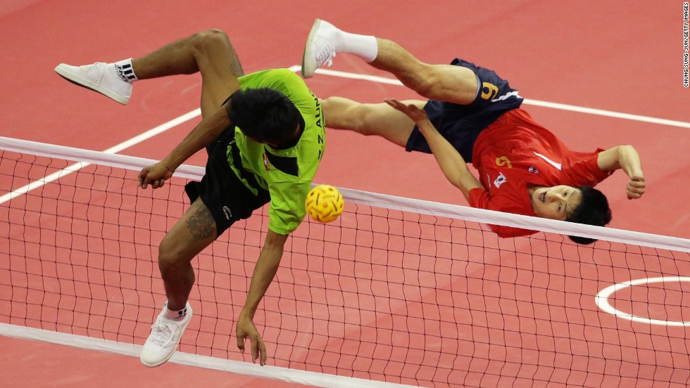 South Korea's Kim Young-man, right, and Myanmar's Zaw Zaw Aung compete for a ball Monday, September 22, during a sepak takraw match at the Asian Games in Incheon, South Korea. Zaw Zaw Aung teamed with Wai Lin Aung and Zaw Latt to win the men's doubles final in sepak takraw, which is sort of like volleyball using your feet.