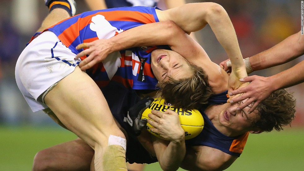 Alexander Urban of the Oakleigh Chargers is tackled by Matt Goodyear of the Calder Cannons during the TAC Cup grand final match, which Oakleigh won Sunday, September 21, in Melbourne. The TAC Cup is an Australian Rules football tournament for players under 18 years of age.