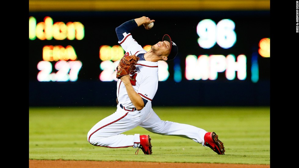 Atlanta Braves shortstop Andrelton Simmons tries to throw out a New York Mets player during a baseball game played Friday, September 19, in Atlanta.