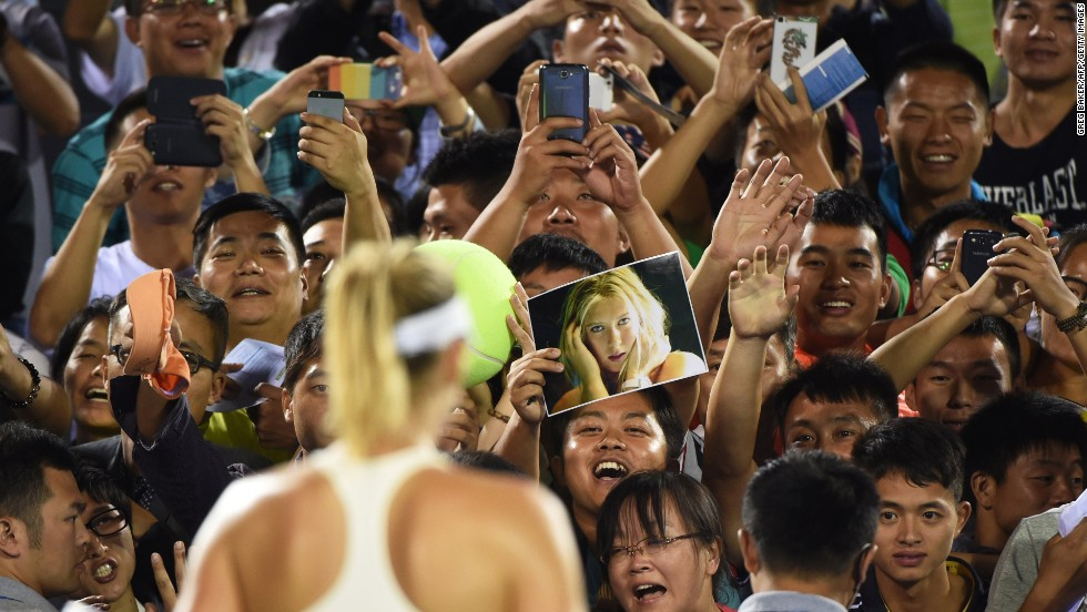 Fans cheer tennis player Maria Sharapova on Monday, September 22, after she defeated Svetlana Kuznetsova at the Wuhan Open in Wuhan, China.