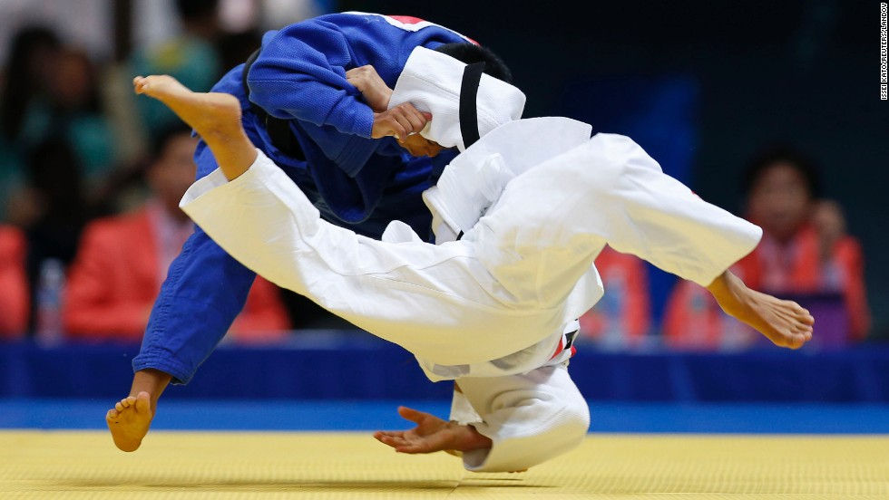 Uzbekistan's Mukaddas Kubeeva, in white, competes against India's Shushila Devi Likmabam during a judo match Saturday, September 20, at the Asian Games in Incheon, South Korea. Likmabam won the match.