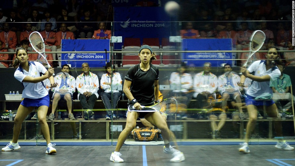 The reflection of Indian squash player Dipika Pallikal is seen on the wall during her Asian Games semifinal match against Malaysia's Nicol Ann David on Monday, September 22. David won and advanced to the gold-medal match.