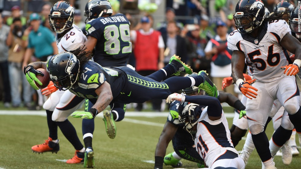 Seattle Seahawks running back Marshawn Lynch dives into the end zone to defeat the Denver Broncos in overtime Sunday, September 21, in Seattle. The Seahawks won 26-20 in what was a rematch of the most recent Super Bowl.
