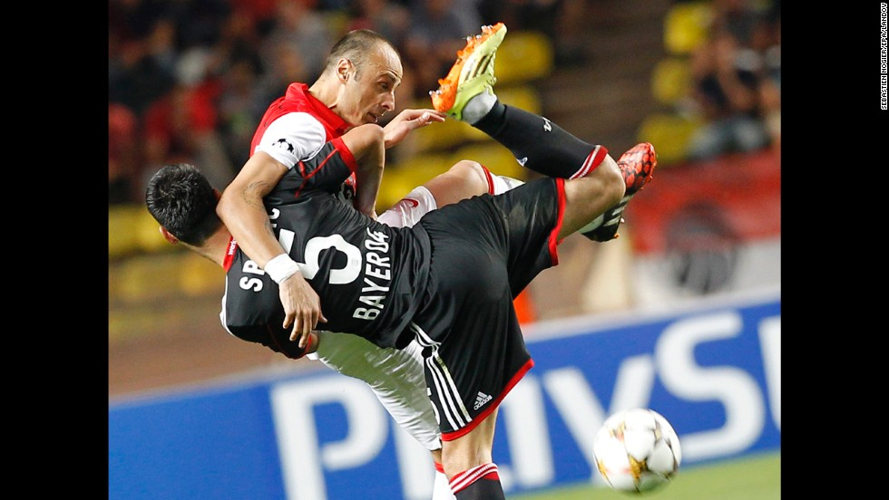 Monaco's Dimitar Berbatov, top, and Bayer Leverkusen's Emir Spahic tussle for the ball Tuesday, September 16, during a UEFA Champions League match in Monaco. Monaco won the match 1-0.