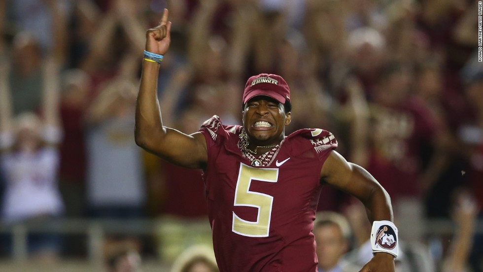 "Florida State quarterback Jameis Winston runs onto the field to celebrate his team's overtime win over Clemson on Saturday, September 20, in Tallahassee, Florida. Winston, last year's Heisman Trophy winner, <a href=""http://www.cnn.com/2014/09/20/us/florida-state-winston-suspension/index.html"">was suspended for the game</a> because of a vulgar comment he made on campus during the week."