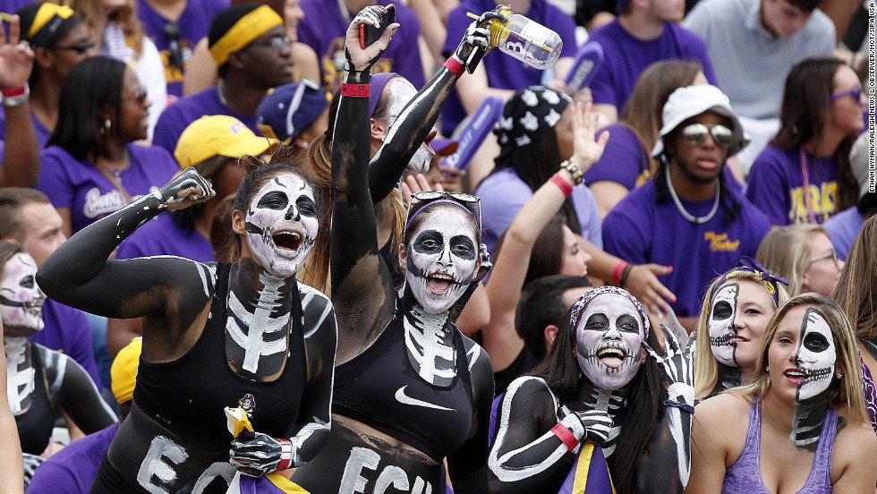 Fans of the East Carolina football team cheer on their Pirates before a home game Saturday, September 20, in Greenville, North Carolina. East Carolina trounced the visiting North Carolina Tar Heels 70-41.