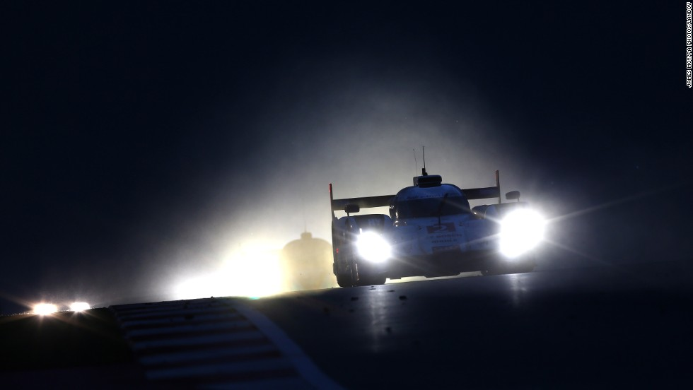 The Audi driven by team members Marcel Fassler, Andre Lotterer and Benoit Treluyer races at night Saturday, September 20, during the FIA World Endurance Championship event held in Austin, Texas.