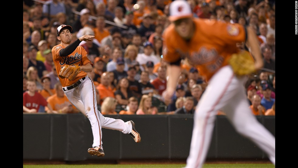 Baltimore Orioles third baseman Ryan Flaherty makes a throw during a home game against the Boston Red Sox on Saturday, September 20.