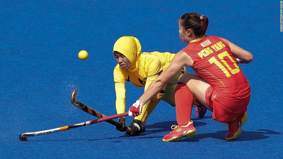 Chinese field hockey player Peng Yang clashes with Malaysia's Raja Norsharina Raja Shabuddin during a match Monday, September 22, at the Asian Games in Incheon, South Korea. China won the match 1-0.