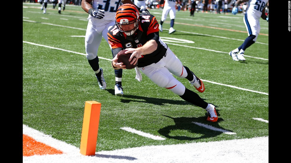 Cincinnati Bengals quarterback Andy Dalton reaches for the pylon during his team's 33-7 victory over the Tennessee Titans on Sunday, September 21. The Bengals are one of three NFL teams still undefeated this season. The Philadelphia Eagles and the Arizona Cardinals are also 3-0.